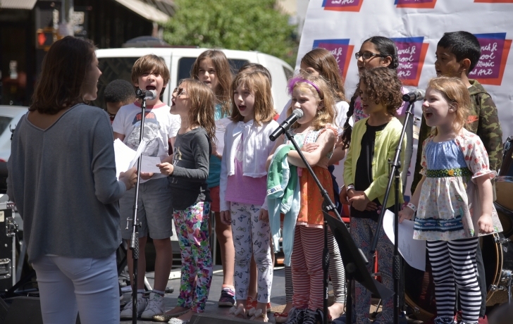 Church Street teaching artist Jacinta Clusellas directs a chorus of Church Street students Photo: Carl Glassman/Tribeca Trib