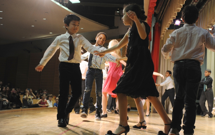 Swing dancing on the P.S. 89 stage.
