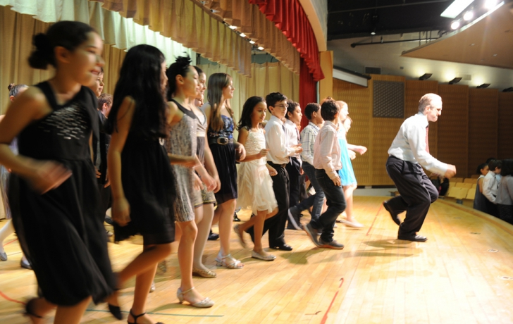 Dance teacher Steve Petrillo leads all the classes in an end of performance stomp.