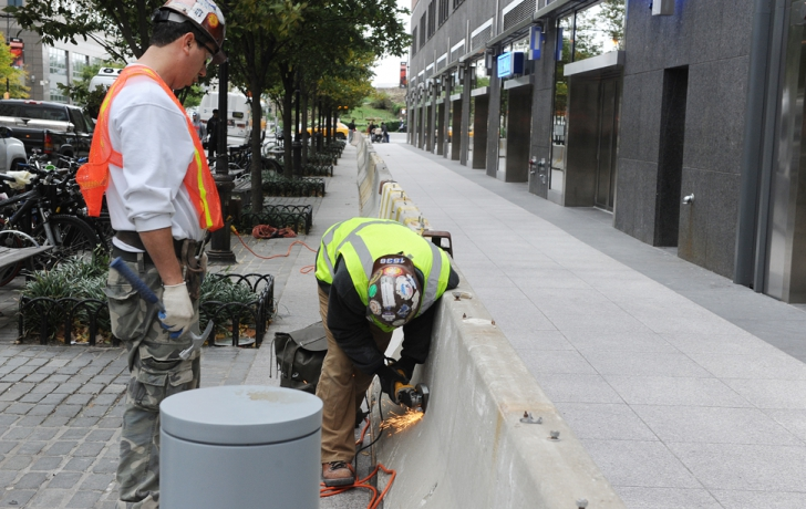 Concrete barriers were erected on the north side of Vesey Street. Sandbags would be placed behind the barriers to protect Goldman Sachs-owned property from water damage. Carl Glassman/Tribeca Trib