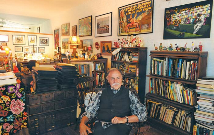 """Brown in the Harrison Street apartment where he has lived with his wife, Lisa Crafts, since 1985 and where they raised their daughter, Jemma, in a funhouse of ephemera from the 1940s, '50s and '60s. He says he has run out of room to collect any more pieces. """"I've basically curtailed my tchotchke accumulation to almost zero,"""" he says."""