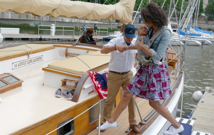 """""""You have some precious cargo there,"""" Capt. Pat Harris tells a mother as she steps aboard the Ventura. During the season kick-off, Harris gave tours of the vessel, build in 1919. Photo: Carl Glassman/Tribeca Trib"""