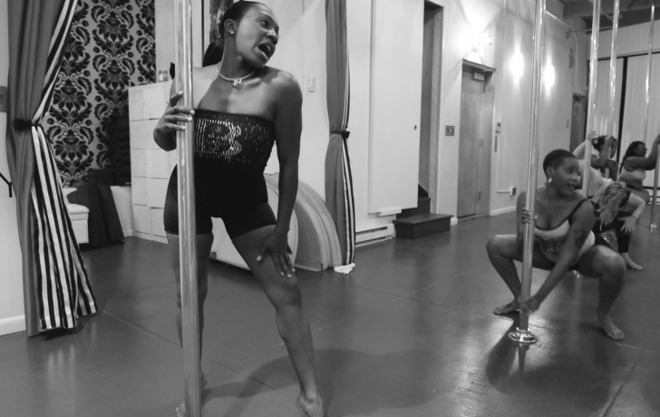 Misha Hart feels the music as she prepares for her next try at a pole move. Photo: Carl Glassman/Tribeca Trib