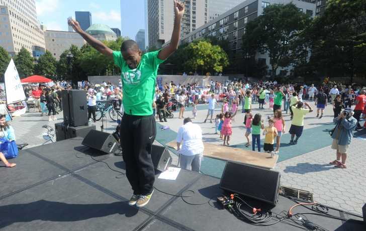 Performers from Asphalt Green led dancing, jumping and gyrating from the block party stage.