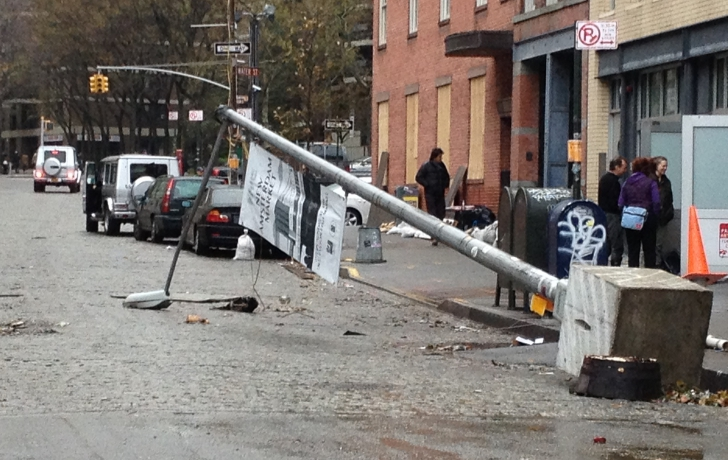 A downed Street light in the Seaport.
